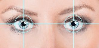 Close-up woman eyes with laser medicine. Stock Images