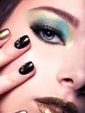 Close-up woman face with creativ eye make-up. Stock Photos