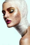 Close up of woman face with glitter on face Stock Photo