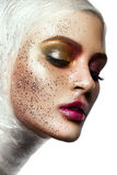 Close up of woman face with glitter on face Royalty Free Stock Photo