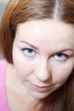 Close up woman face looking at camera Royalty Free Stock Photos