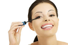 Woman face with mascara brush Royalty Free Stock Photo