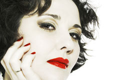Close-up woman face with red lips. Desaturation close-up woman face with red lips and red nails Stock Images