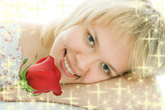 Close-up woman face with rose flower. And starlet Royalty Free Stock Images