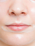 Close up woman in facial peel off mask. Royalty Free Stock Photos