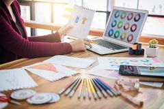 Close up of woman fashion designer at work drawing sketches for. Clothes in atelier with tailor tool and color charts, profession and job occupation, Fashion Royalty Free Stock Images