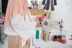 Woman fashion designer working. Close up of woman fashion designer working in the office Stock Photos