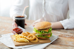 Close up of woman with fast food and cocacola Stock Image