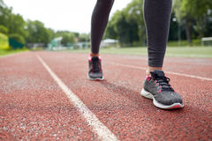 Close up of woman feet running on track from back Stock Photo
