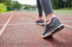 Close up of woman feet running on track from back Stock Photos