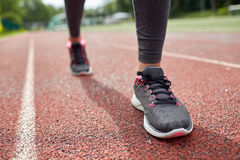 Close up of woman feet running on track from back Royalty Free Stock Photo