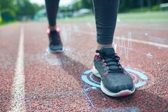 Close up of woman feet running on track Stock Images