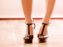Close up woman feet wearing high heels on floor Stock Photography