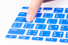 Close up woman finger on enter button blue keyboard cover Stock Photos