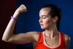 Close-up of woman flexing muscles in gym Royalty Free Stock Images