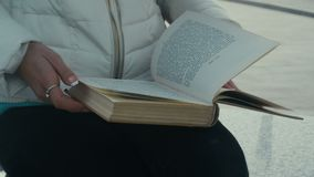 Woman flips the pages of the book stock footage