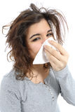 Close up of a woman with flu and  a handkerchief in the nose. Isolated on a white background Stock Photos