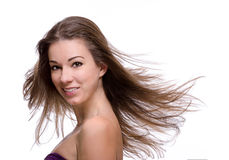 Close up of woman with flying hair Stock Photography