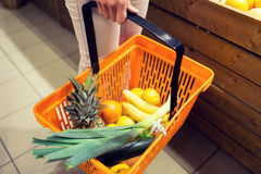 Close up of woman with food basket in market Royalty Free Stock Photos