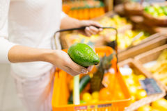 Close up of woman with food basket in market Royalty Free Stock Photo