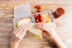 Close up of woman with food in plastic container Royalty Free Stock Images