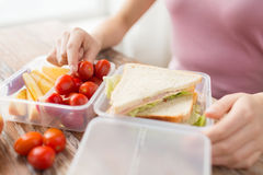 Close up of woman with food in plastic container Stock Photography