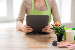 Close up of woman or gardener holding tablet pc Royalty Free Stock Photos