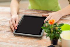 Close up of woman or gardener with tablet pc Royalty Free Stock Photography