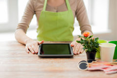 Close up of woman or gardener with tablet pc Royalty Free Stock Image