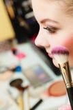 Close up woman getting make up, blush. Visage concept. Close up woman getting make up on cheeks. Applying blush with brush Royalty Free Stock Images