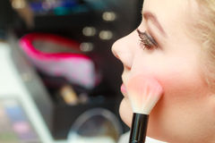 Close up woman getting make up, blush Royalty Free Stock Photos