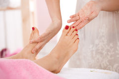 Close up of woman getting relaxing massage on feet Royalty Free Stock Photography