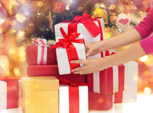 Close up of woman with gifts and christmas tree Stock Image