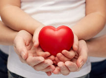 Close up of woman and girl hands holding heart Royalty Free Stock Images