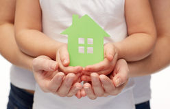 Close up of woman and girl hands with paper house Royalty Free Stock Photos