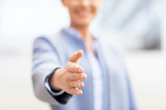 Close up of woman giving hand for handshake Royalty Free Stock Photos