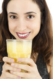 Close up of woman with a glass of banana smoothie Royalty Free Stock Photo