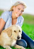 Close up of woman with golden retriever in the park Stock Images