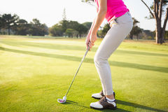 Close up of woman golfer preparing her shot Stock Photos