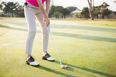 Close up of woman golfer preparing her shot Royalty Free Stock Photos