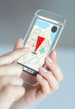 Close up of woman with gps navigator on smartphone. Business, technology, navigation and people concept - close up of woman hand holding and showing transparent Stock Photos