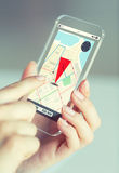 Close up of woman with gps navigator on smartphone Royalty Free Stock Photo