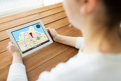 Close up of woman with gps navigator on tablet pc Stock Photography