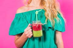 Close up of woman with green smoothie on pink background Stock Photography