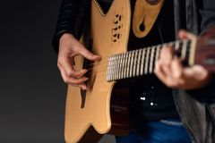 Close-up of woman with guitar Stock Photo