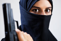 Close-up of woman with a gun Royalty Free Stock Photo