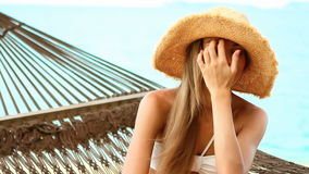 Close up of woman on hammock at the exotic beach stock video footage