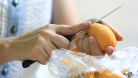 Close-up woman hand chopping an Marian plum stock footage