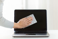 Close up of woman hand cleaning laptop screen Stock Photography