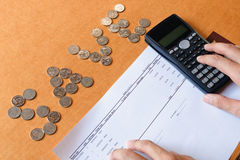 Close up woman hand counting calculator on desk,savings, financ royalty free stock photo